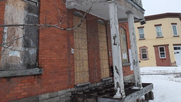 The Claude Lauzon Group owns many townhouses such as this one that have fallen into a state of disrepair.
