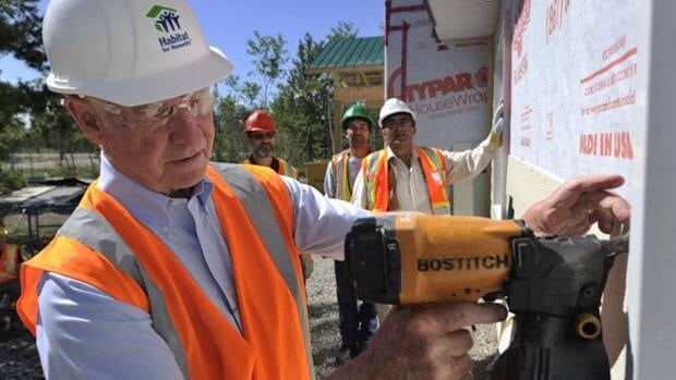 Gov. Gen. David Johnston helps out at a Habitat for Humanity project Tuesday at the Takhini River Subdivision on Champagne and Aishihik First Nations lands near Whitehorse, Yukon.
