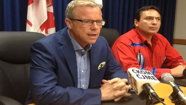 Brad Wall and Perry bellegarde signed an agreement to talk.