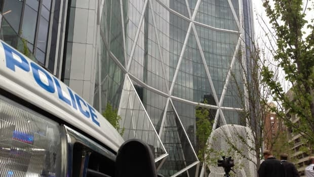 Police conducted a floor-by-floor search for a man who they say yelled threats inside The Bow tower in downtown Calgary Tuesday.