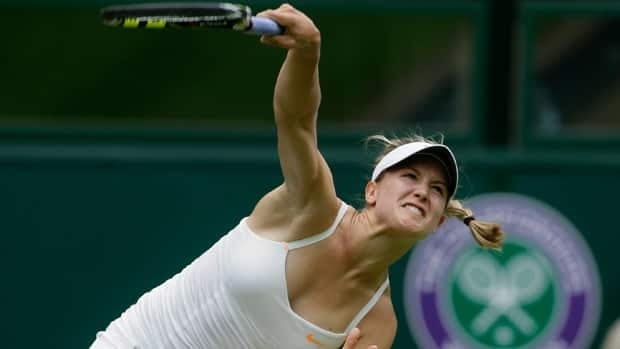 Eugenie Bouchard follows through on a serve during her big second round win Wednesday at All England Club.