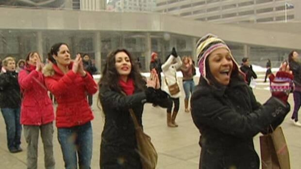 Women dance at the One Billion Rising in Nathan Phillips Square in Toronto on Thursday, Feb. 14.
