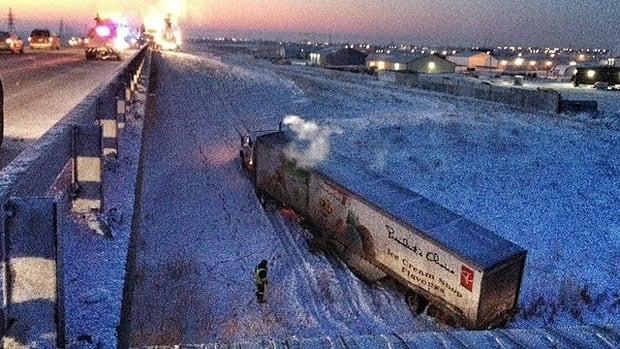 A semi went down a bridge embankment in Winnipeg on Tuesday.