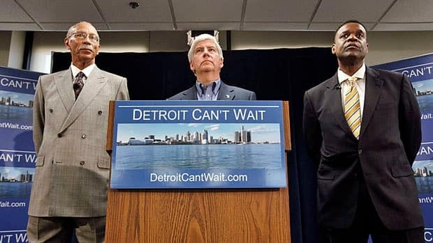 Detroit Mayor Dave Bing, left, Michigan Governor Rick Snyder and emergency financial manager Kevyn Orr are trying to fix Detroit's finances.