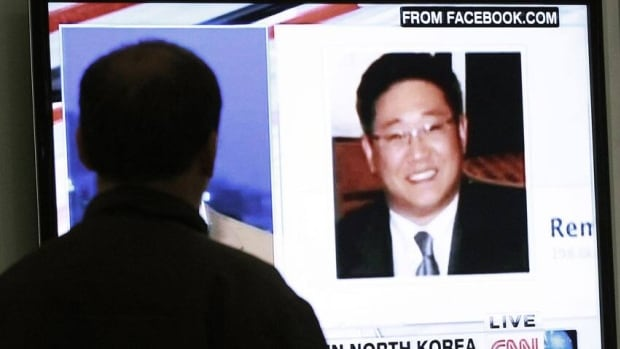 A South Korean man watches a TV news program showing Korean-American Kenneth Bae. Bae has been sentenced to 15 years of hard labour in North Korea for hostile acts against the state, the North's media said Thursday.