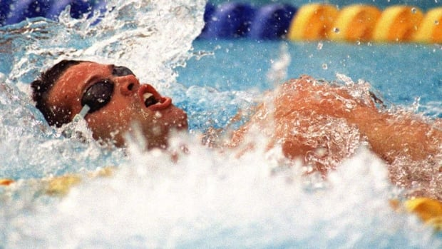 Canadian Mark Tewksbury of Calgary churns through the water on his way to a gold medal and Olympic record time of 56.98 seconds in the men's 100-metre backstroke in 1992 in Barcelona.