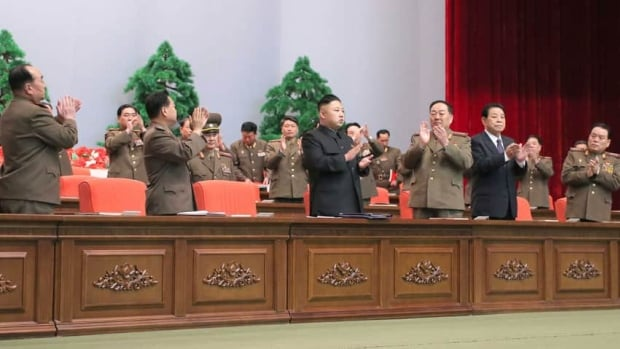 North Korean leader Kim Jong-un (centre) attends a meeting of information workers of the whole army in Pyongyang on March 28, 2013.