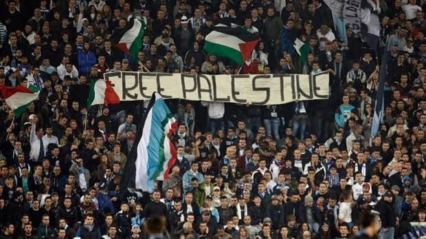 Lazio fans hold a banner reading Free Palestine during a Europa League Group J soccer match between Lazio and Tottenham Hotspur on Jan. 3.