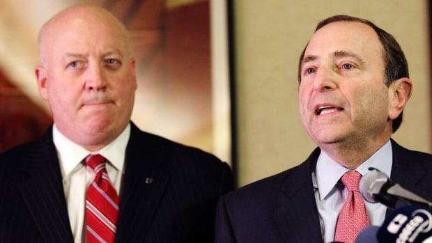 NHL Commissioner Gary Bettman, right, and deputy commissioner Bill Daly, seen in this file photo from Dec., 2012, met with members of the Glendale City Council to discuss a lease deal for the Phoenix Coyotes' arena.