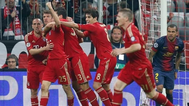 Bayern's Thomas Muller, second from left, celebrates after scoring the opening goal during the Champions League semifinal first leg match against FC Barcelona in Munich, Germany, on Tuesday. Muller added another in the 4-0 rout.