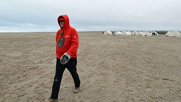 Who could walk a mile in his shoes? Prime Minister Stephen Harper leaves the Canadian Ranger camp near Gjoa Haven, Nunavut on Wednesday. He will be running in the next election, he says.