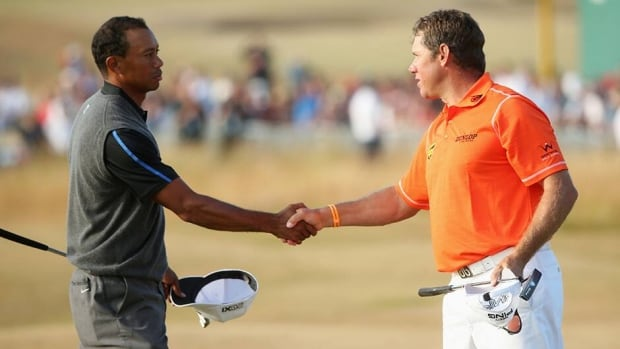 Tiger Woods shakes hands with Lee Westwood after finishing the third round of the 142nd Open Championship at Muirfield on July 20, 2013 in Gullane, Scotland.