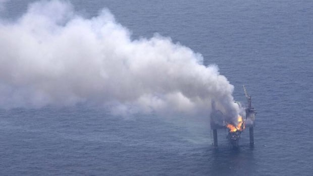 A fire burns on the Hercules 265 drilling rig in the Gulf of Mexico, off the coast of Louisiana, on Wednesday, July 24, 2013.