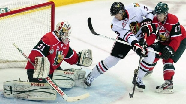 In this May 26, 2013 file photo, Portland Winterhawks'S Seth Jones, centre, goes to the net in front of Halifax Mooseheads right winger Darcy Ashley, right, as Mooseheads goaltender Zachary Fucale defends during the first period of the Memorial Cup final hockey game in Saskatoon, Saskatchewan.