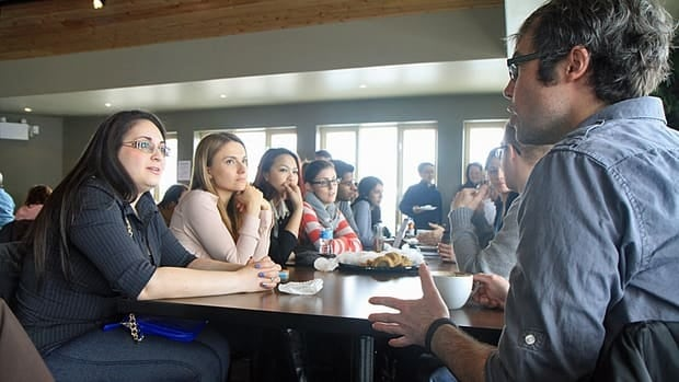 McMaster University continuing education instructor Jared Lenover speaks with some of his students at Hamilton's first Geek Breakfast at Williams Fresh Cafe on the Hamilton waterfront Saturday morning.