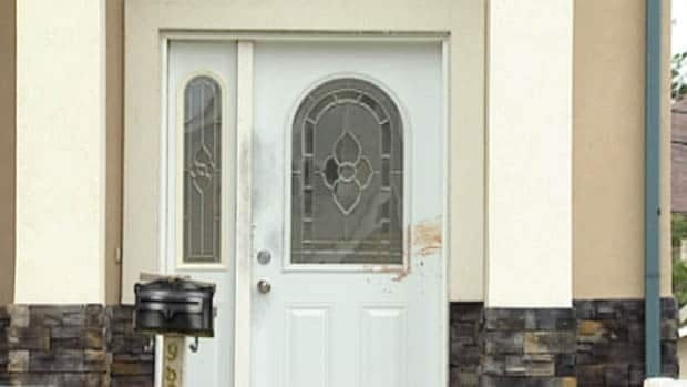 Blood is still evident on the front door of the second house involved in the series of attacks after the third victim managed to fight off the suspect using a machete.