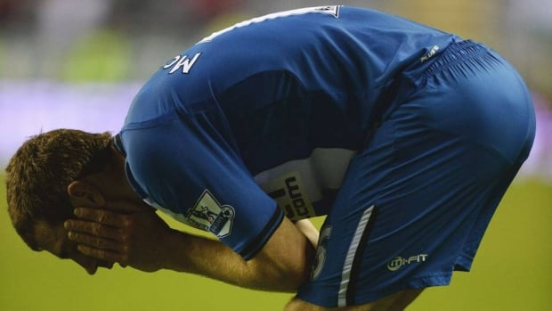 James McArthur of Wigan Athletic looks dejected after defeat against Swansea City at DW Stadium on Tuesday in Wigan, England.