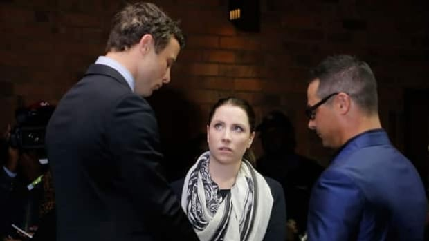 Oscar Pistorius, left, prays with his sister Aimee and brother Carl prior to Monday's indictment in Pretoria Magistrates Court at which he was charged with premeditated murder and ordered to stand trial on March 3.