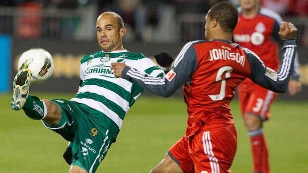 The Toronto FC offence will be partially entrusted to Jamaican international Ryan Johnson, right, in Wednesday's match against Santos Laguna. Toronto has scored just 35 goals in 33 MLS games this season.