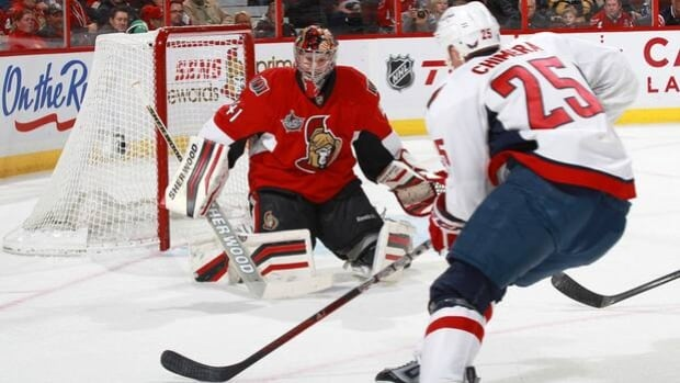 Senators netminder Craig Anderson (41) is tested by forward Jason Chimera in a 5-3 home loss to the Capitals on Dec. 7, 2011.