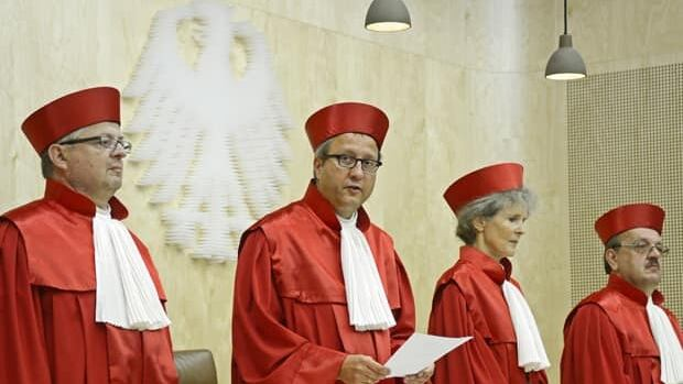 Andreas Vosskuhle, second left, presiding judge of the German Constitutional Court, is flanked by other judges as he announces their verdict on the permanent eurozone rescue fund in Karlsruhe, southern Germany, on Wednesday.