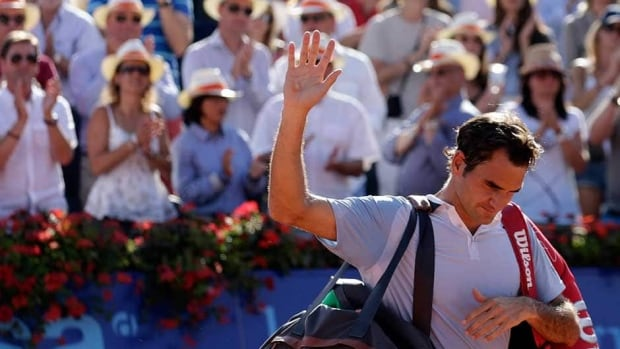 Switzerland's Roger Federer waves to the crowd after losing to Germany's Daniel Brands in the second round of the Swiss Open in Gstaad on Thursday.