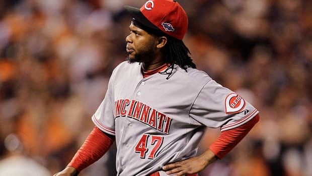 A 19-game winner this season, Reds pitcher Johnny Cueto, seen here grabbing his side, was forced to leave Game 1 of the NLDS after throwing eight pitches.