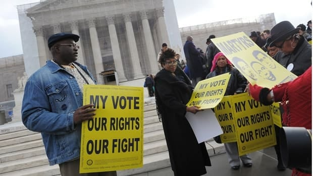 Activists distribute pro-voting rights placards outside of the U.S. Supreme Court on Wednesday in Washington, D.C.
