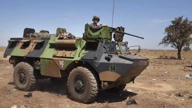 French soldiers drive a military vehicle at a Malian air base in Bamako on Tuesday. The French army sent some 50 armoured vehicles to Mali from its military base in Ivory Coast.