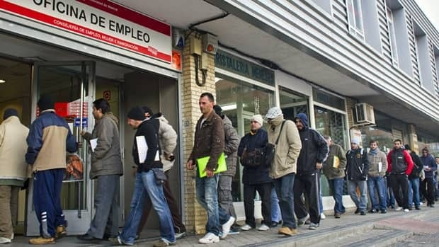 People lineup outside an unemployment registry office in Madrid in December. Spain's youth unemployment rate has hit a record 51 per cent.