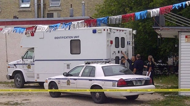 The Winnipeg Police Service's forensic identification unit at the scene of an investigation on Burrows Avenue near Main Street on Sunday afternoon.