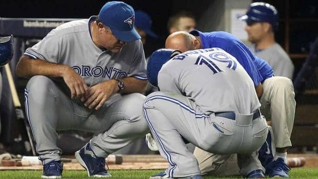 Toronto Blue Jays' manger John Farrell, left, talks with Jose Bautista after he injured his wrist during the eighth inning against the New York Yankees on Monday in New York.