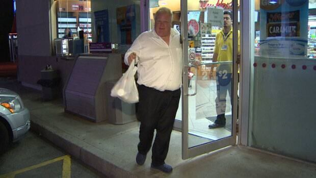 Mayor Rob Ford leaves an Etobicoke gas station at around 1 a.m. on Saturday after walking from his house to pick up a few snacks.