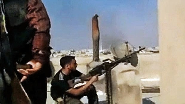 A still image from amateur video purports to show a Free Syrian Army soldier firing his weapon during clashes with Syrian government troops in Aleppo. Fighting on Thursday stretched into its sixth day in the commercial capital.