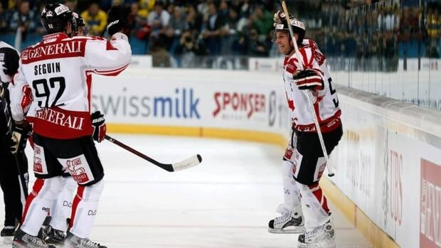 Team Canada's Ryan Smyth, right, celebrates his goal against HC Davos on Thursday during the 86th Spengler Cup in Davos, Switzerland.