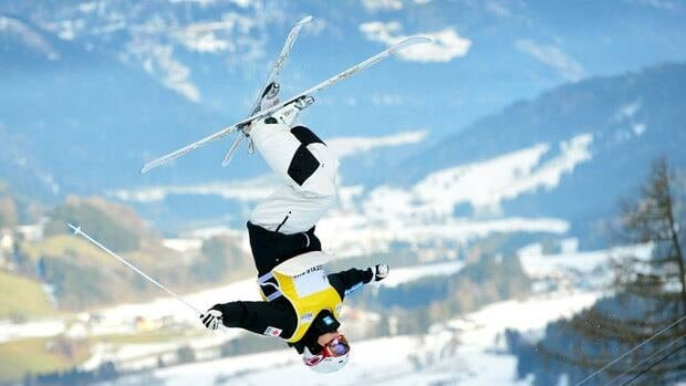 Canada's Mikael Kingsbury jumps to a bronze medal in the men's dual moguls competition Saturday in Kreischberg, Austria.