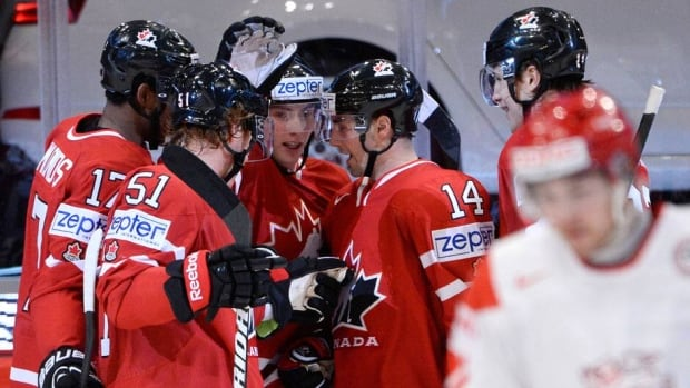 Wayne Simmonds, Brian Campbell, Matt Duchene, Jordan Eberle and Luke Schenn celebrate a goal in Canada's 3-1 win over Denmark at the world hockey championship Saturday in Stockholm, Sweden.