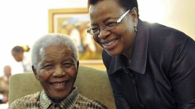 Former South African president Nelson Mandela and his wife, Graca Machel, after they cast early ballots in local elections in Johannesburg, South Africa, in May 2011. On Tuesday, South African President Jacob Zuma said Mandela is in good spirits in hospital in Pretoria.