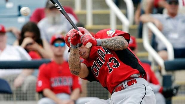 Canada's Brett Lawrie, seen in Tuesday's game against the Brewers, left Wednesday's game against the Reds after suffering an injury.