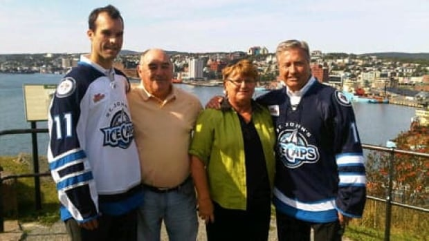 IceCaps president Danny Williams (right) with hockey fans on Sept. 22.