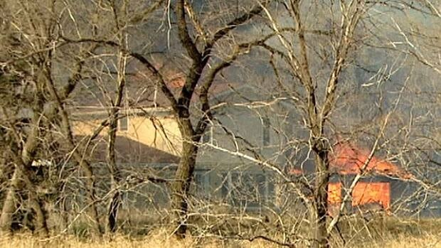 Fire consumes one of the barns on the Bokhari farm on Saturday.