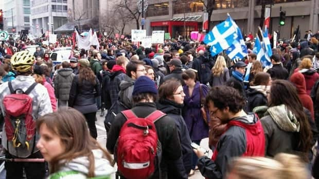 Students block Sherbrooke Street in downtown Montreal, across from McGill University's Desautels Faculty of Management.