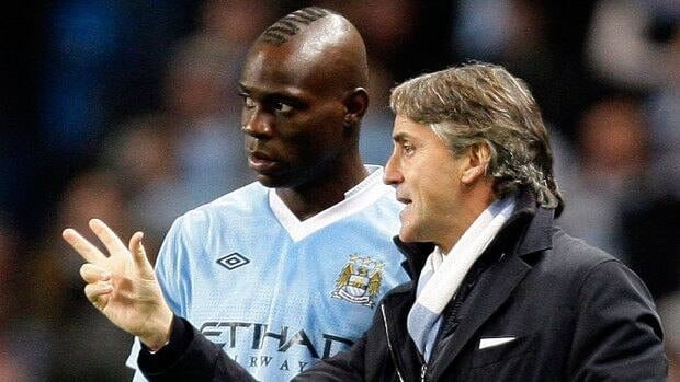 In this Dec. 21, 2011 file photo, of Manchester City's manager Roberto Mancini, right, issues instructions to Mario Balotelli against Stoke. The two appeared to get into a training ground altercation Thursday.