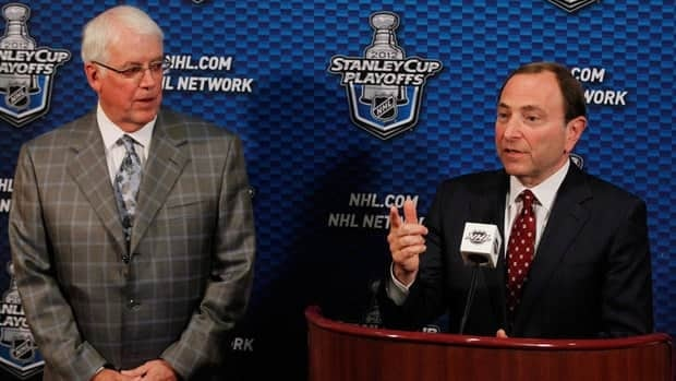 NHL Commissioner Gary Bettman, right, and prospective Phoenix Coyotes owner Greg Jamison, left, speak to the media last month about the proposed sale of the team.