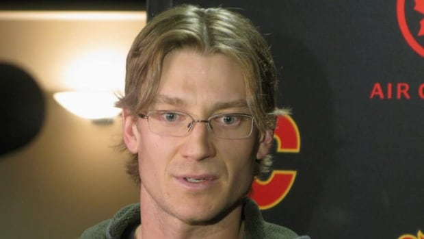 Defenceman Jay Bouwmeester speaks to reporters in Calgary on Tuesdayregarding his trade from the Calgary Flames to the St. Louis Blues.