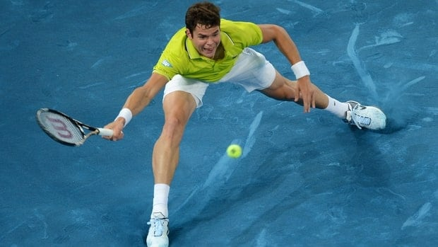 Canadian Milos Raonic returns a ball against Roger Federer during their match on Wednesday.