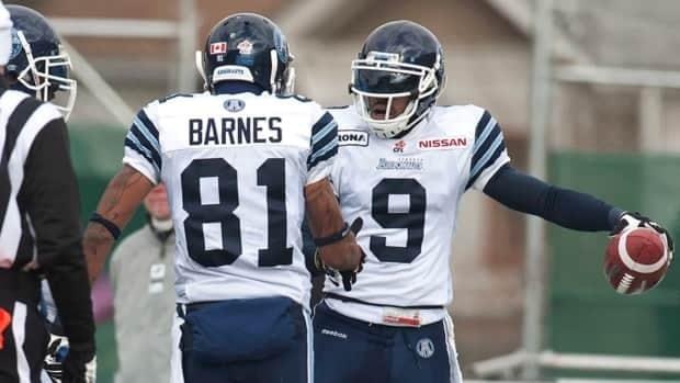 Toronto Argonauts wide receiver Maurice Mann and slotback Jason Barnes celebrate a touchdown during the first quarter against the Saskatchewan Roughriders on Saturday.