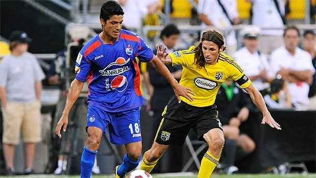 Frankie Hejduk #2 of the Columbus Crew defends against Gustavo Cabrera #18 of C.S.D. Municipal of Guatemala.