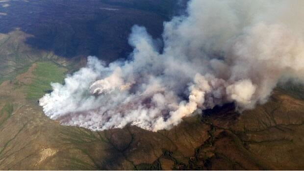 A lightning-caused fire burns Thursday in the Mayo district, four kilometres north of the Snake River.