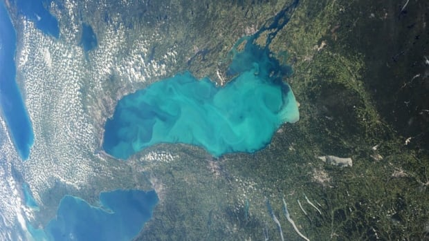 A photo taken by an astronaut on the International Space Station shows Lake Ontario's brilliant blue hue last week. The phenomenon used to be more common on the lake.
